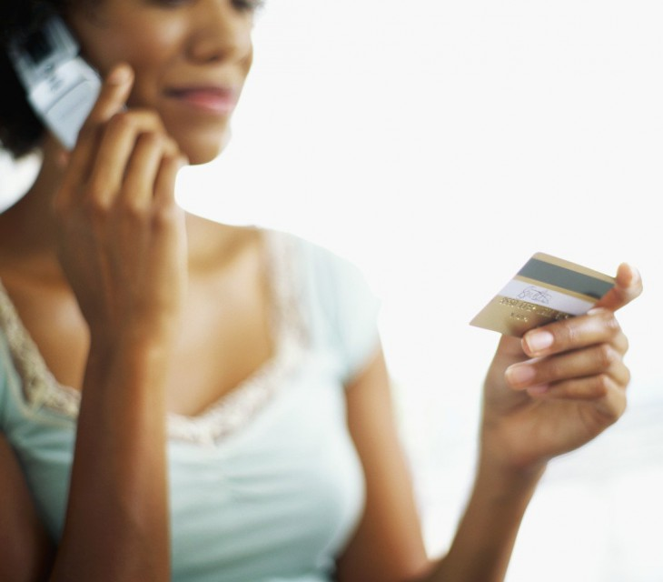 woman on the phone with credit card